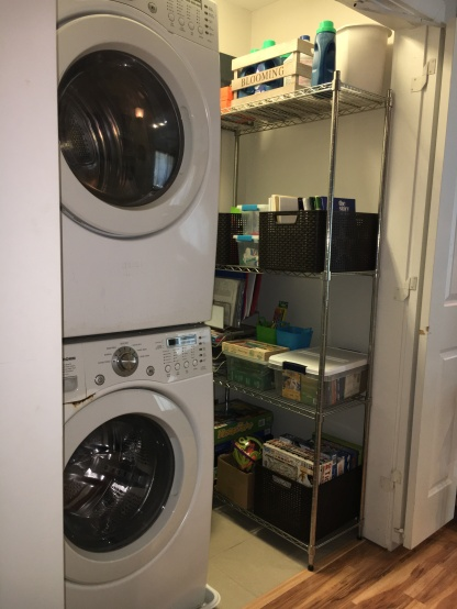 Stacked washer/ dryer and metal shelves